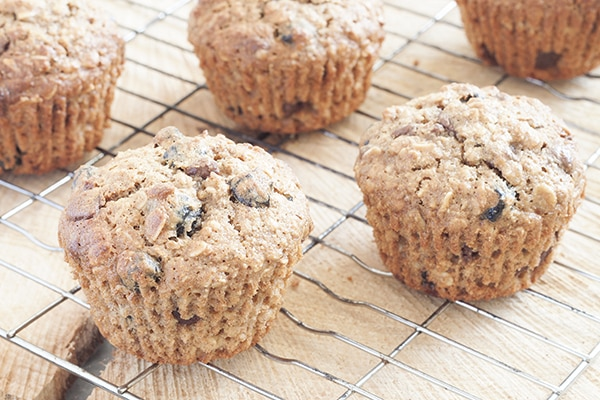 Blueberry & Chocolate Granola Muffins - Wake up to these tasty, healthy muffins packed with blueberries., chocolate, nuts and honey | cookbakeeat.com #muffins #breakfast #healthy